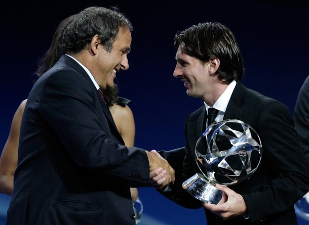 FC Barcelona's Lionel Messi receives the UEFA Club Footballer of the Year award from UEFA president Michel Platini at Monaco's Grimaldi Forum in Monte-Carlo