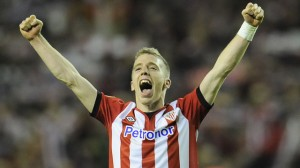 Athletic Bilbao forward Iker Muniain has insisted that he is happy at the club amid speculation linking the 19-year-old with a move to Bayern Munich.