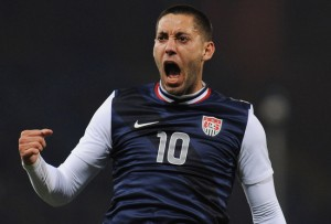 Tottenham's Clint Dempsey scored an injury-time goal to give his side a 1-1 draw with Manchester United