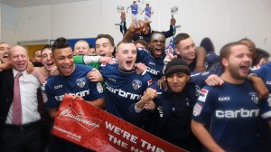 The Oldham players celebrate after defeating Liverpool 3-2 in the FA Cup fourth round
