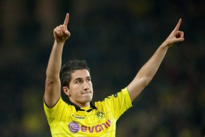 Real Madrid midfielder Nuri Sahin has completed a magnificent return to two-time German champions Borussia Dortmund on a long-term loan deal.
