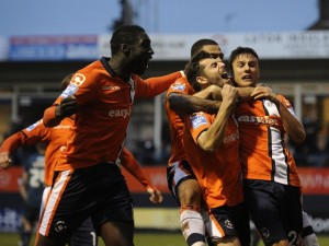 Luton's Alex Lawless is mobbed by teammates after scoring the winning goal in the Hatters 1-0 FA Cup victory against Wolves