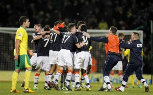 Luton players celebrate their 1-0 victory at Premier League Norwich