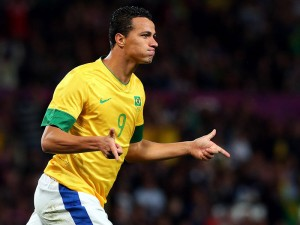 Brazil international striker Leandro Damiao has thanked Tottenham Hotspur for showing a recurring interest in him, but insists that he is happy to stay at Internacional.