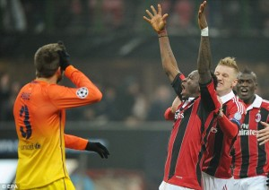 Sulley Muntari celebrates after scoring AC Milan's second goal in their 2-0 defeat of Barcelona