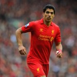 Luis Suarez has revealed he is happy at Liverpool amid speculation linking him with a summer move away from Anfield.