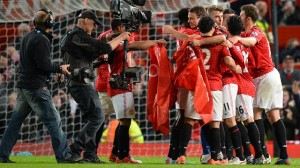 Manchester United players celebrate securing the clubs 20th English league title after beating Aston villa 3-0 last night
