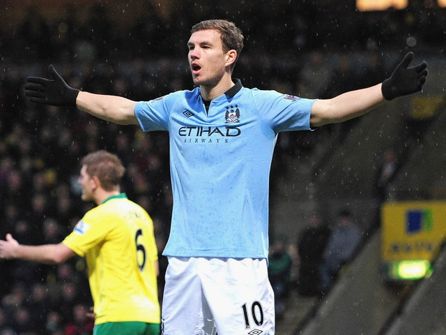 Jurgen Klopp has admitted Borussia Dortmund need to 'think about' the transfer speculation linking the club with Edin Dzeko.