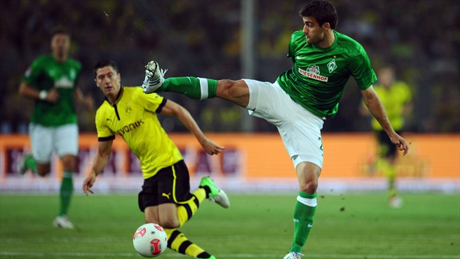 UEFA Champions League runners-up Borussia Dortmund have completed the signing of Werder Bremen defender Sokratis Papastathopoulos on a five-year contract.