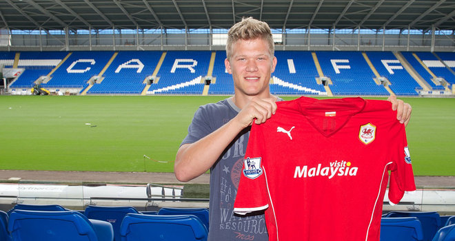 Denmark international striker Andreas Cornelius has completed a move from F.C. Copenhagen to Cardiff City on a five-year contract.
