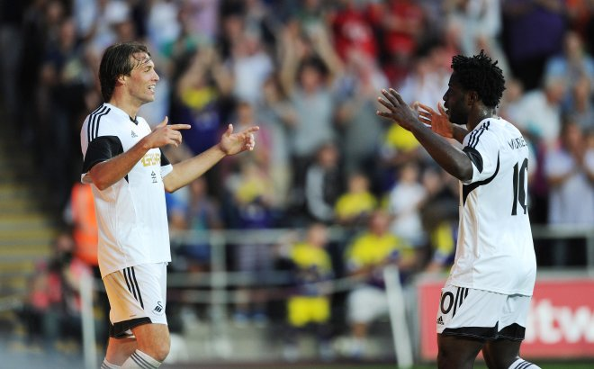 Swansea City A.F.C. striker Wilfried Bony has urged Michu to stay at the Liberty Stadium amid reported interest from Arsenal.