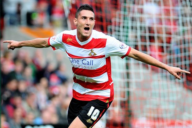 Doncaster Rovers have completed the signing of highly-rated Manchester United striker Federico 'Kiko' Macheda on a short-term loan deal.