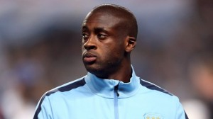 Manchester City midfielder Yaya Toure has played down speculation suggesting he is not happy at the Etihad Stadium.
