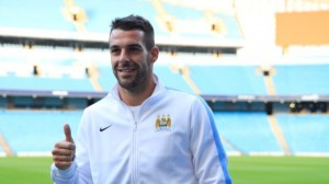 Spanish striker Alvaro Negredo scored a hat-trick as Manchester City defeated CSKA Moscow 5-2 to qualify for the last 16 of the Champions League