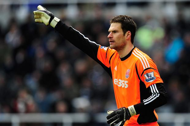 Stoke City goalkeeper Asmir Begovic has revealed he is flattered by speculation linking him with a summer move to Real Madrid, while insisting he is 'happy' at the Britannia Stadium.