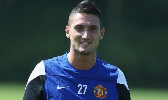 Cardiff City F.C. have announced the signing of former Manchester United forward Federico Macheda on a three-year deal.