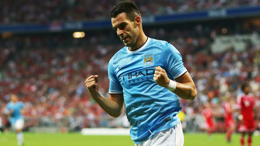 Alvaro Negredo has revealed he is 'happy' and 'settled' at Manchester City F.C. amid reports linking him with a return to Spain.