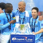 Manchester City players celebrate with the Capital One Cup last season