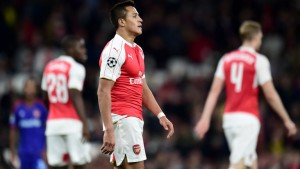 Arsenal star Alexis Sanchez look disappointed after the Gunners were defeated 3-2 at home against Olympiakos in the Champions League