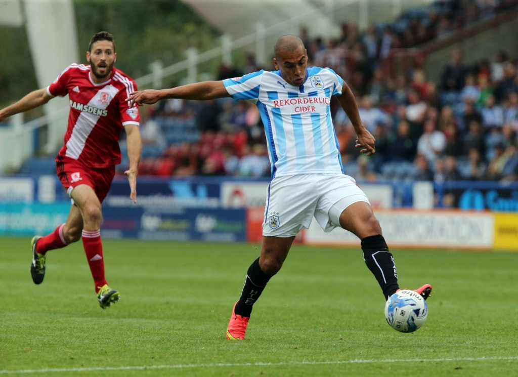 Huddersfield Town A.F.C. manager Chris Powell has revealed striker James Vaughan is back in contention for a first-team place despite being told he would not be offered a new deal in the summer.