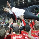 The Wales players celebrate victory with boss Chris Coleman